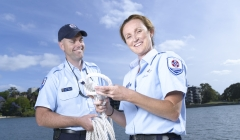 image for Two maritime officers standing with rope near water